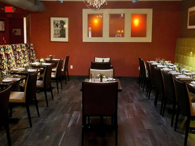 restaurant interior of the restaurant wooden tables dim lighting warm atmosphere ariane kitchen and bar verona new jersey united states ulocal local products local purchase local produce locavore tourist