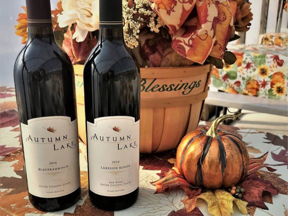 vineyard 2 bottles of red wine near a bouquet with autumn colors autumn lake winery williamstown new jersey united states ulocal local products local purchase local produce locavore tourist