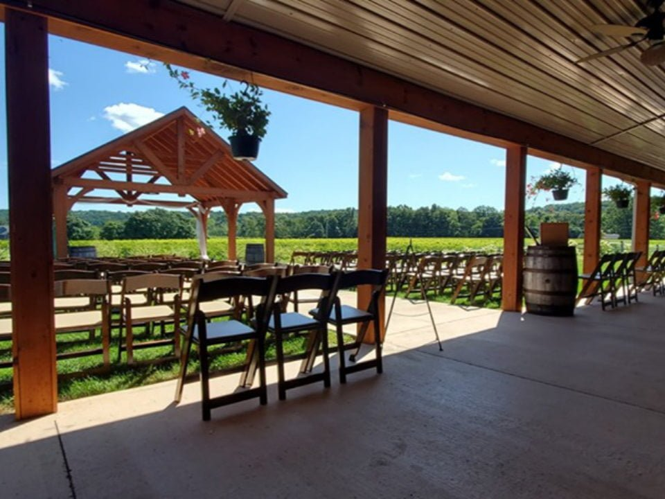 vineyard wonderful location for special events with vineyard views cement patio wooden chairs brook hollow winery columbia new jersey united states ulocal local products local purchase local produce locavore tourist