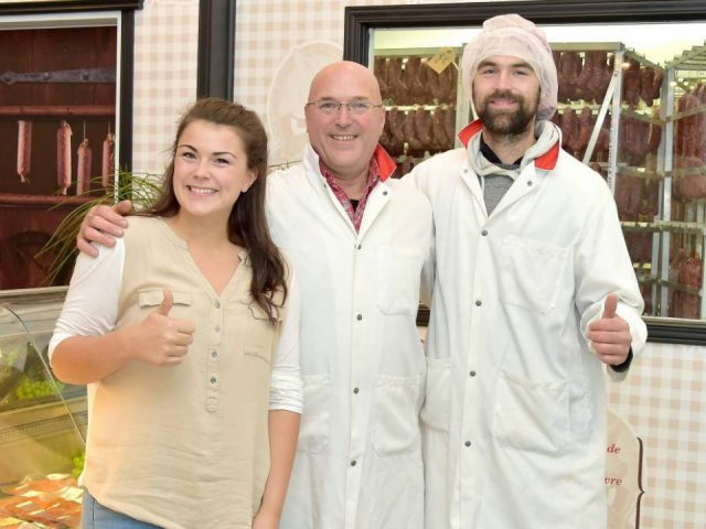 butcher shop the family tremblay gabrielle lyn and fabrice in Charlevoix with the butcher shop in the background charcuterie charlevoisienne saint-urbain quebec canada ulocal local products local purchase local produce locavore tourist
