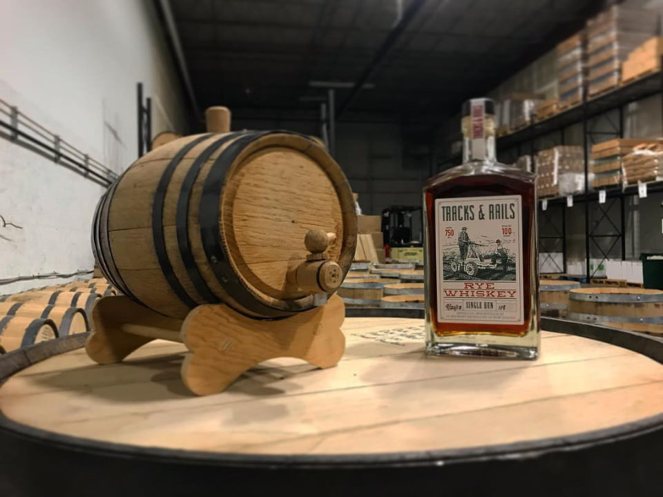 liquor bottle of rye whiskey on a wooden barrel in the cellar claremont distillery fairfield new jersey united states ulocal local products local purchase local produce locavore tourist