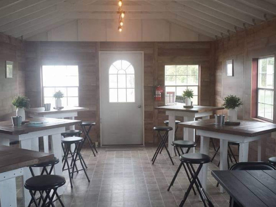 vineyard tasting room with 6 square tables with chairs cozy place dibella winery woolwich township new jersey united states ulocal local products local purchase local produce locavore tourist