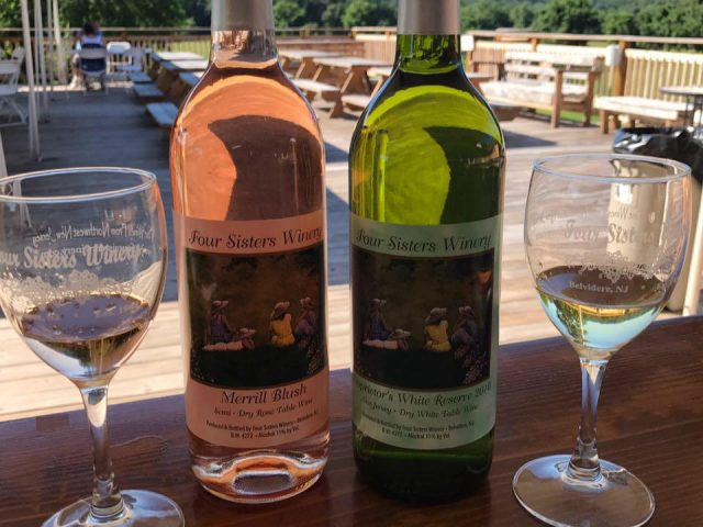 vineyard 2 bottles and 2 glasses of white wine a rosé with a beautiful four sisters winery belvidere new jersey united states ulocal local products local purchase local produce locavore tourist