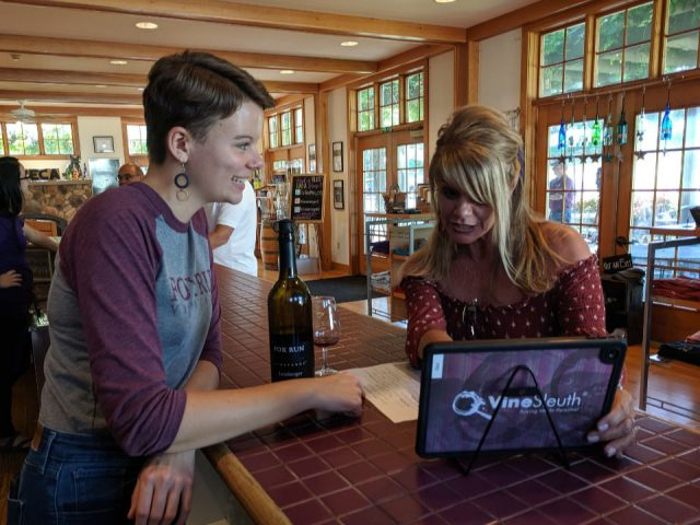 vineyards staff with a customer equipped with a tablet to adjust the basic characteristics of the wine in a personalized way for tasting fox run vineyards penn yan new york united states ulocal local products local purchase local produce locavore tourist