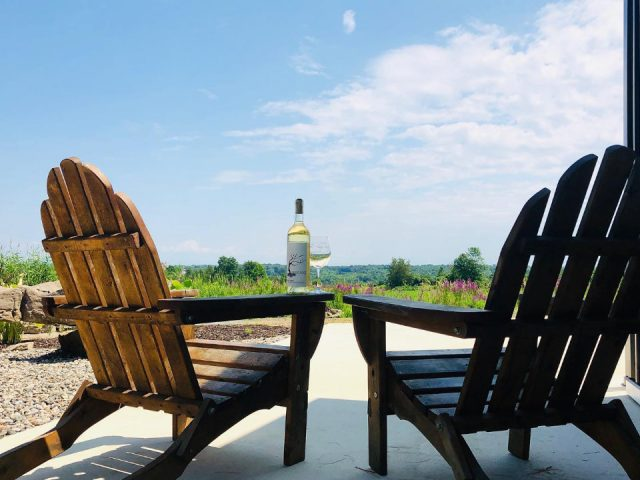 vineyards two chairs a bottle and glass of white wine and beautiful summer view galway rock vineyard and winery ballston lake new york united states ulocal local products local purchase local produce locavore tourist