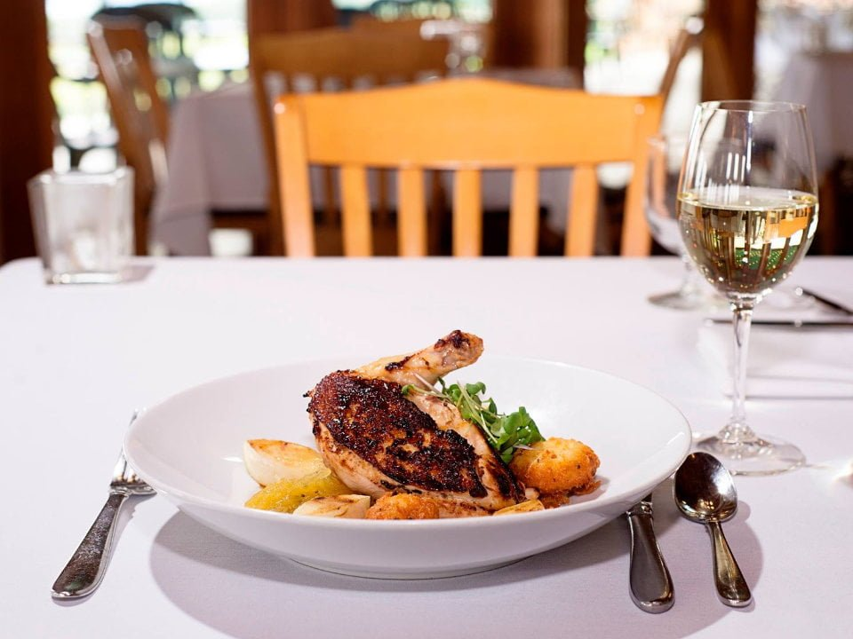 vineyards dish of local ingredients with chicken and vegetables and glass of white wine glenora wine cellars dundee new york united states ulocal local products local purchase local produce locavore tourist
