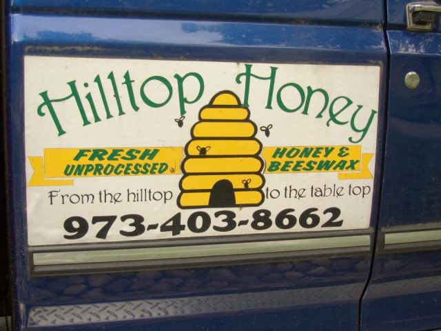 beekeeping company signboard on truck door hilltop honey north caldwell new jersey united states ulocal local products local purchase local produce locavore tourist