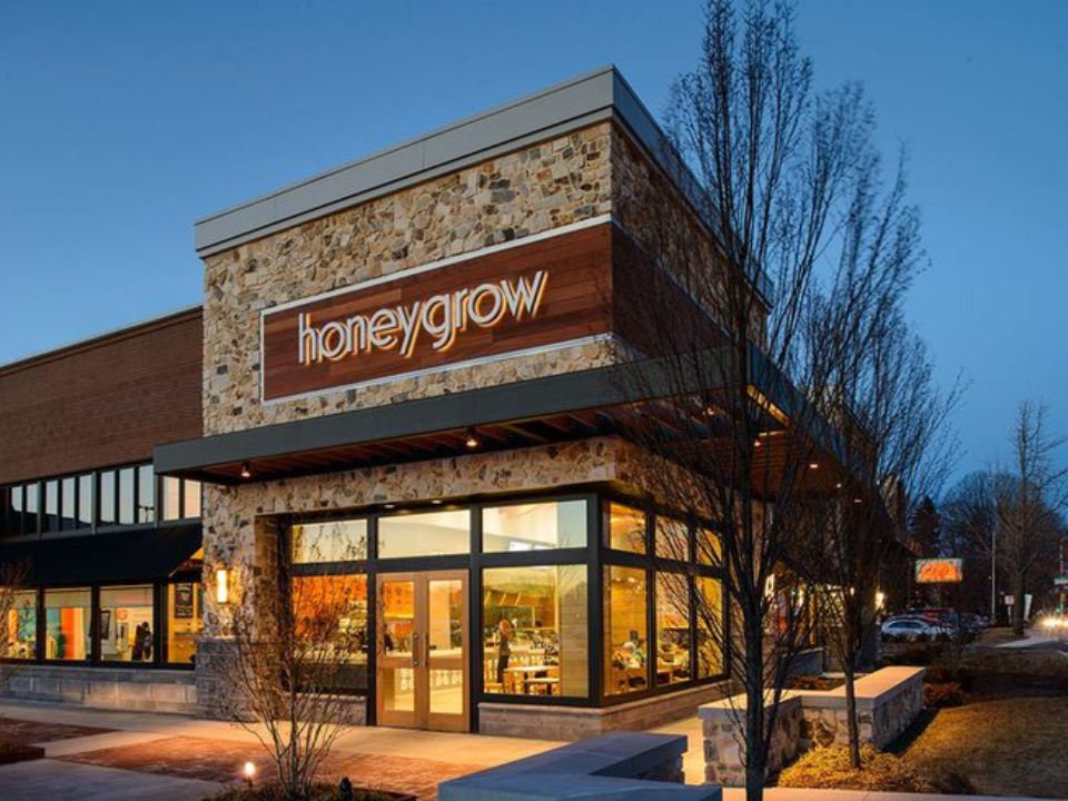 restaurant exterior facade with large windows of the restaurant on the corner of the street honeygrow cherry hill Ccherry hill new jersey united states ulocal local products local purchase local produce locavore tourist