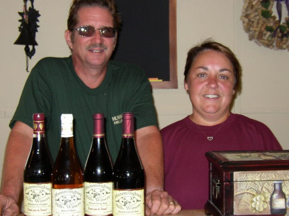 vineyards 2 owners with 4 bottles of red wine hummingbird hills winery fultonville new york united states ulocal local products local purchase local produce locavore tourist