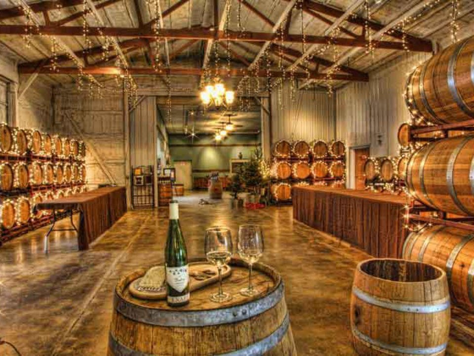 vineyards rustic tasting room surrounded by cedar barrels and well illuminated with bottle and glass of wine on a barrel knapp winery romulus new york united states ulocal local products local purchase local produce locavore tourist