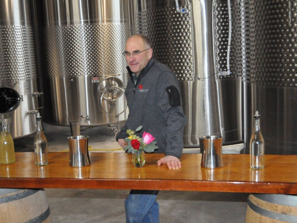 vineyards man in wine production room with stainless steel tanks and tasting table lakewood vineyards watkins glen new york united states ulocal local products local purchase local produce locavore tourist