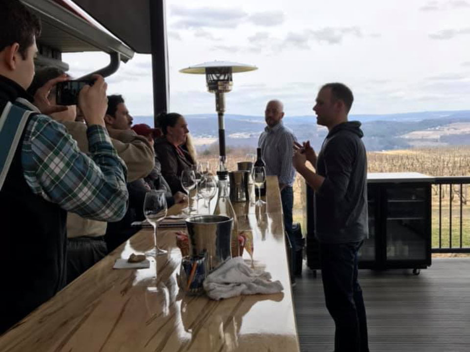 vineyards tasting room with large bar with employee who explains his wines and magnificent view of the vineyard lakewood vineyards watkins glen new york united states ulocal local products local purchase local produce locavore tourist
