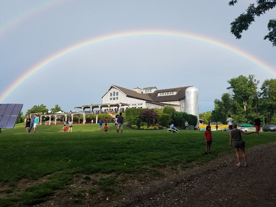 vineyard view of winery estate with rainbow above house large grassy lot with people laurita winery new egypt new jersey united states ulocal local products local purchase local produce locavore tourist