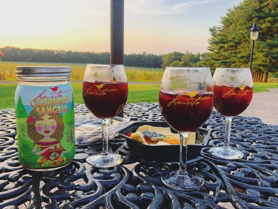 vineyard laurita legendary sangria with 3 glasses of sangria and cheese dish on a table overlooking the land laurita winery new egypt new jersey united states ulocal local products local purchase local produce locavore tourist
