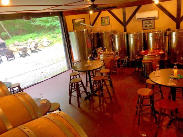 vineyards wine tasting room in the winery with steel tanks and garage door open to the outside with patio chairs ledge rock hill winery corinth new york united states ulocal local products local purchase local produce locavore tourist