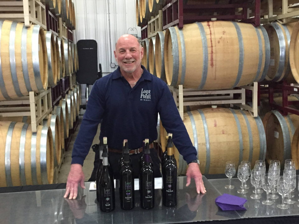vineyards happy and entertaining winemaker in the wine cellar ready for a tasting long point winery aurora new york united states ulocal local products local purchase local produce locavore tourist