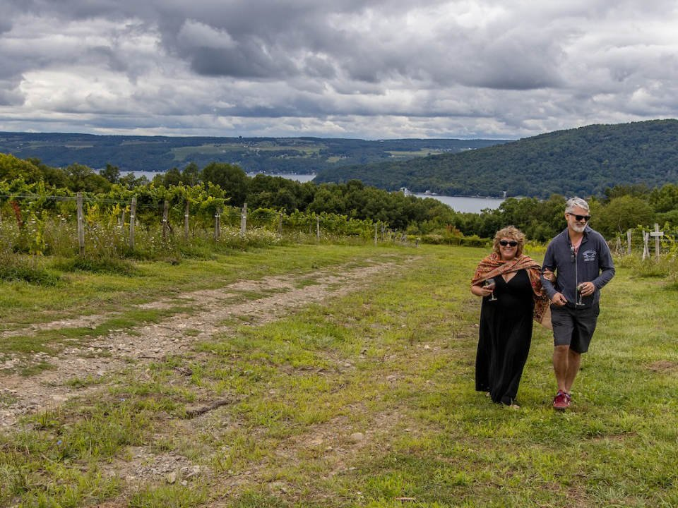 vineyards man and woman in the field surrounded by vineyards and lake view mcgregor vineyard dundee new york united states ulocal local products local purchase local produce locavore tourist