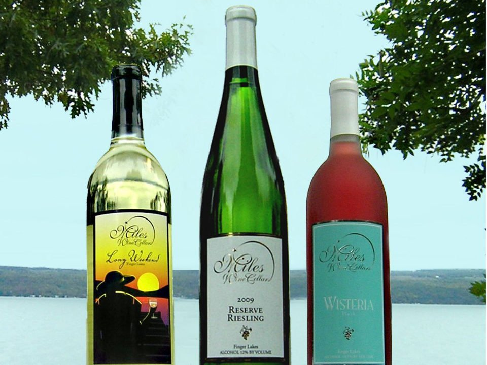 vineyards 3 diversified bottles of wine on the terrace with lake view miles wine cellars himrod new york united states ulocal local products local purchase local produce locavore tourist
