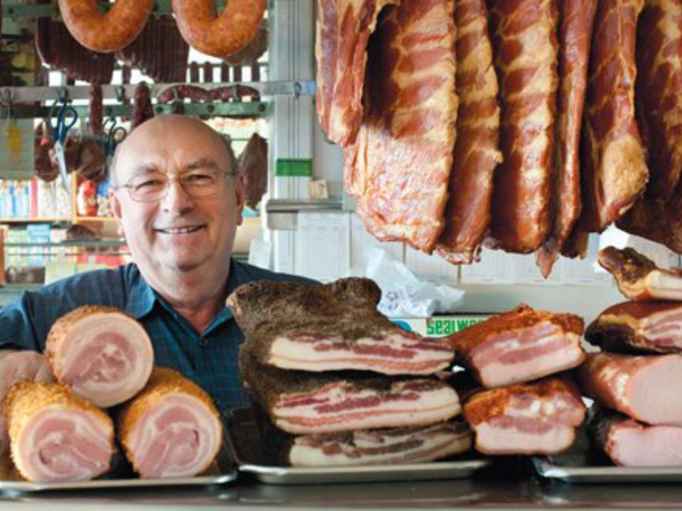 butcher shop owner surrounded by hanging sausages and cold cuts muncan food corp astoria astoria new york united states ulocal local products local purchase local produce locavore tourist