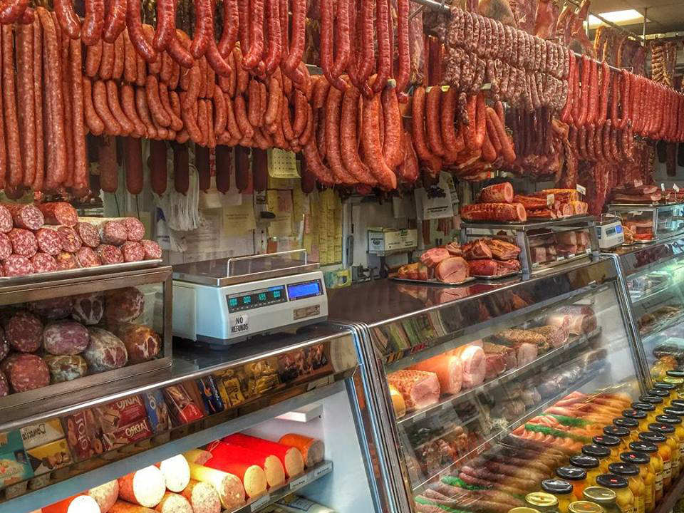 butcher shop inside the butcher's shop with a lot of cold cuts and hanging sausages muncan food corp astoria astoria new york united states ulocal local products local purchase local produce locavore tourist