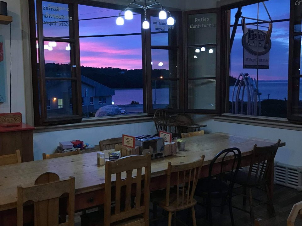 artisan bakeries long wooden table near the window with beautiful night view of the bay pains d'exclamation la malbaie quebec canada ulocal local products local purchase local produce locavore tourist