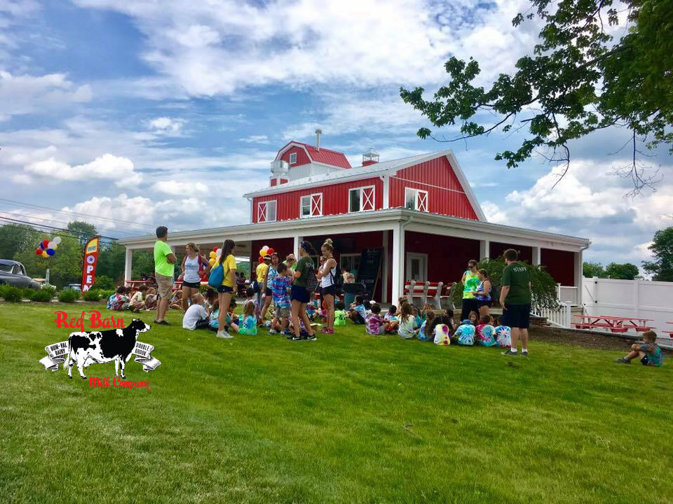 restaurant red farmhouse and large lot with rest area and picnic tables with children's customers on the ground red barn milk co ringoes new jersey united states ulocal local products local purchase local produce locavore tourist