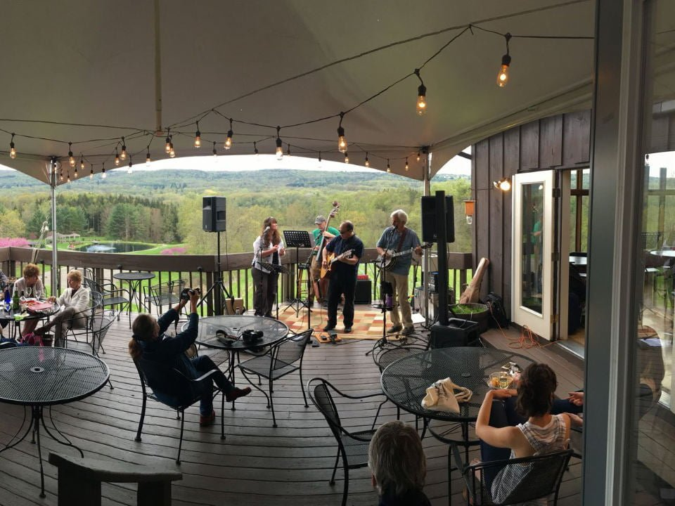 vineyards terrace with live band and guests sitting at the tables and view of the estate six mile creek vineyard ithaca new york united states ulocal local products local purchase local produce locavore tourist