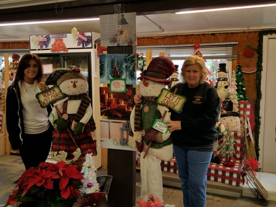 produce markets market interior with snowman and holiday greetings decorations with 2 women tony morellis market glendora new jersey united states ulocal local products local purchase local produce locavore tourist