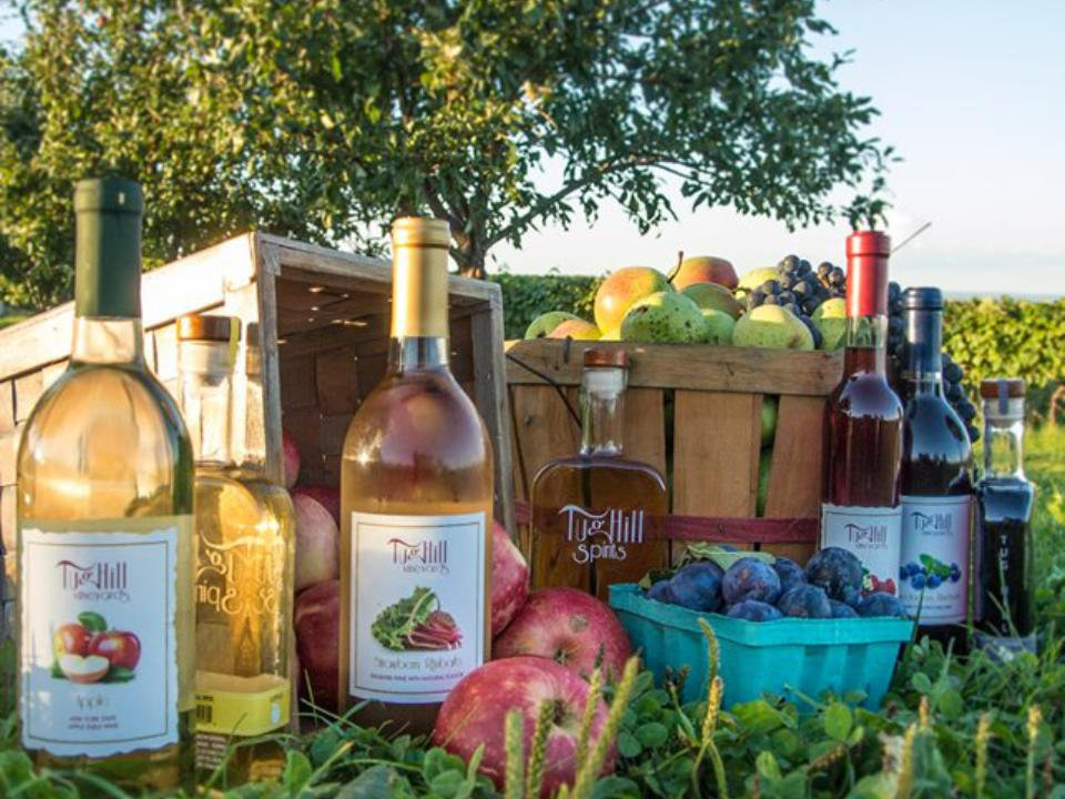 vineyards bottles of wine and sprices produced by the vineyard with fruit basket grown in the field tug hill vineyards lowville new york united states ulocal local products local purchase local produce locavore tourist
