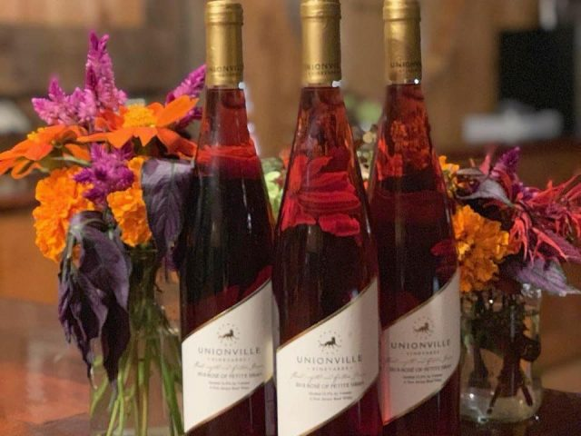 vineyard 3 bottles of petit syrah rosé wines with flower decoration unionville vineyards ringoes new jersey united states ulocal local products local purchase local produce locavore tourist