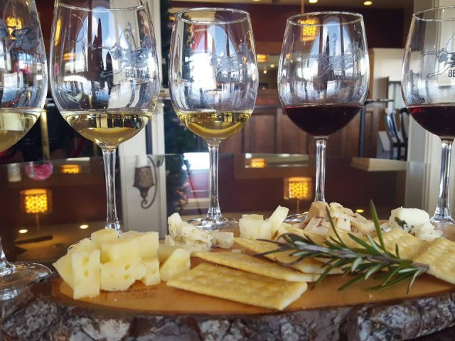 vineyards assortment of several glasses of wine on a table with cheese in the tasting room villa bellangelo dundee new york united states ulocal local products local purchase local produce locavore tourist