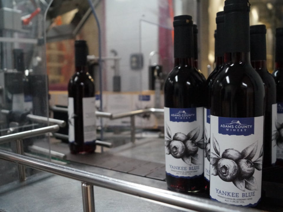 vineyards wine bottling line with yankee blue bottles adams county winery orrtanna pennsylvania united states ulocal local products local purchase local produce locavore tourist