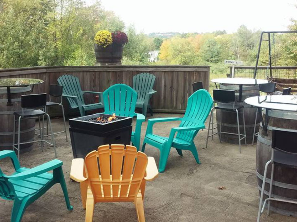 vineyards terrace with patio chairs and table with wooden barrel base and fireplace in the middle amherst farm winery amherst massachusetts united states ulocal local products local purchase local produce locavore tourist