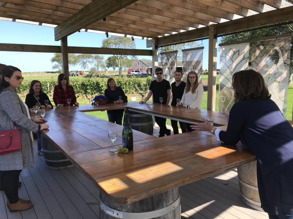vineyards large outdoor table under a roof bottle and glass of wine for tasting with customers carolyns sakonnet vineyard little compton rhode island united states ulocal local products local purchase local produce locavore tourist