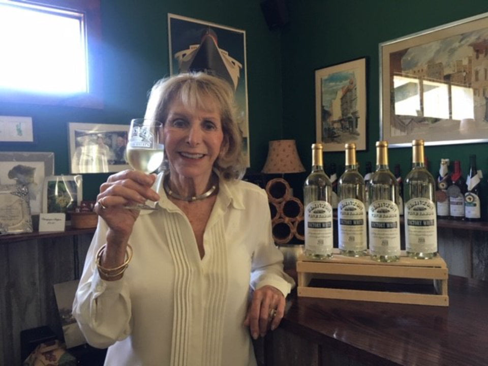 vineyards owner presenting her new wine 42d vintage of seyval white victory white with a glass in her hands and bottles next to her clinton vineyards clinton corners new york united states ulocal local products local purchase local produce locavore tourist