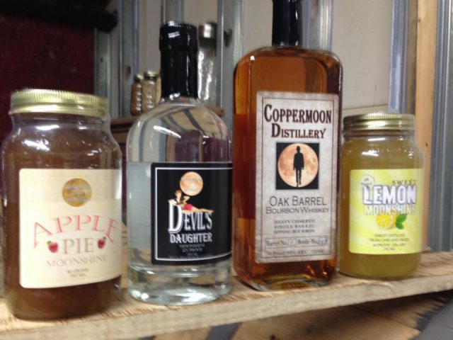 liquor assortment of spirits bottles from the distillery copper moon distillery indian orchard massachusetts united states ulocal local products local purchase local produce locavore tourist