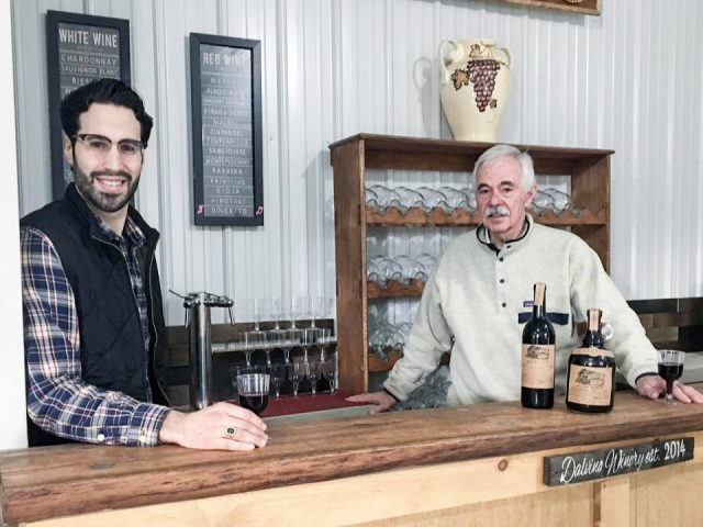vineyards the winemaker and the owner at the tasting bar with glass of red wine in their hand and bottle of wine on the bar dalvino wine company sunbury pennsylvania united states ulocal local products local purchase local produce locavore tourist
