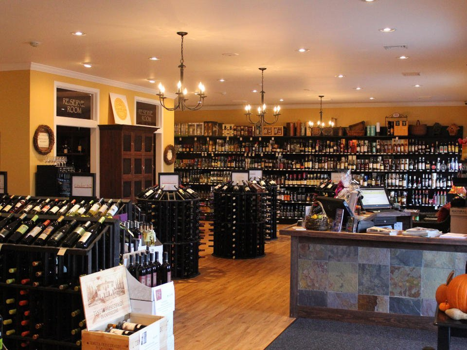 boutique interior of the wine shop with several displays in the center and on the wall grapes and grains barrington rhode island united states ulocal local products local purchase local produce locavore tourist
