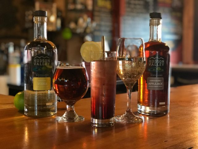 liquor bottles and glasses of alcohol on the wooden bar hudson valley distillers germantown new york united states ulocal local products local purchase local produce locavore tourist