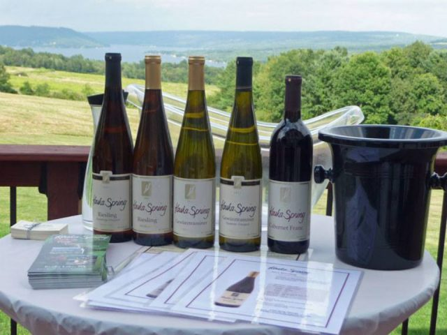 vineyards 5 bottles of wine with a bucket on a picnic table outside overlooking the vineyard and the lake keuka spring vineyards penn yan new york united states ulocal local products local purchase local produce locavore tourist