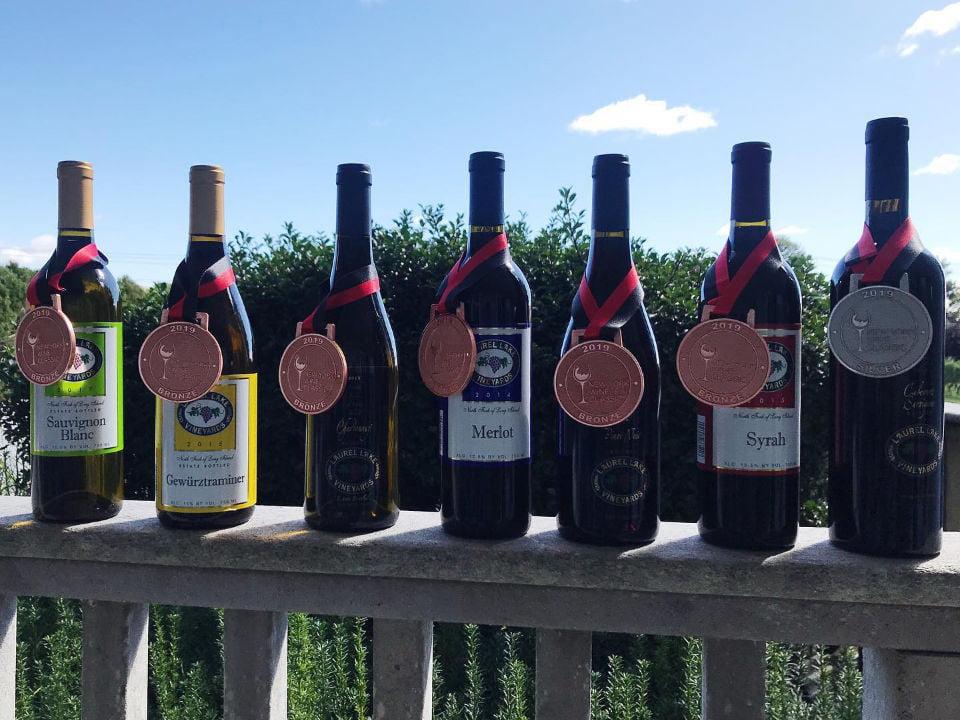 vineyards assortment of award-winning wine bottles on the edge of the balcony laurel lake vineyards laurel new york united states ulocal local products local purchase local produce locavore tourist