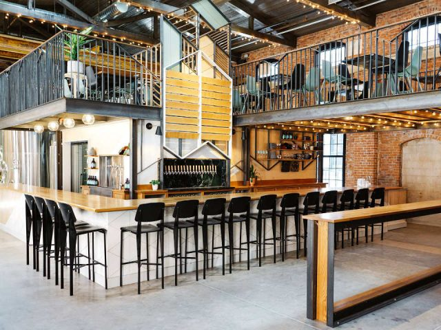 microbreweries tasting room on two floors with mezannine and large bar with black benches and brewing space long live beerworks providence rhode island united states ulocal local products local purchase local produce locavore tourist