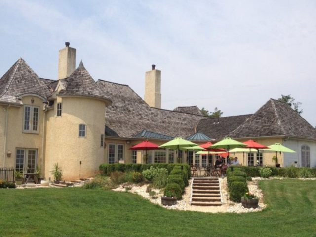 vineyards french country castle overlooking estate with a large terrace with umbrellas moon dancer vineyards and winery wrightsville pennsylvania united states ulocal local products local purchase local produce locavore tourist