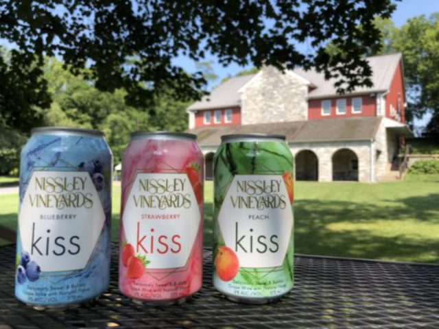 vineyards 3 cans of fruit drinks from the vineyard with building and land nissley vineyards bainbridge pennsylvania united states ulocal local products local purchase local produce locavore tourist