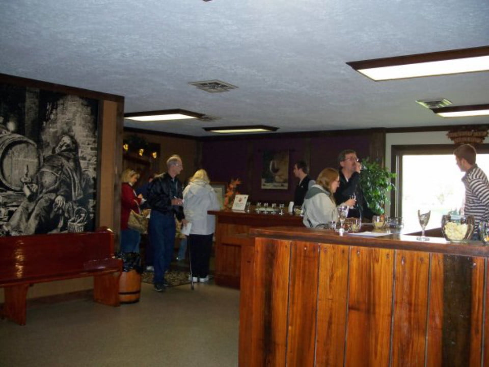 vineyards interior of the tasting room with customers at the bar penn shore winery and vineyards north east pennsylvania united states ulocal local products local purchase local produce locavore tourist