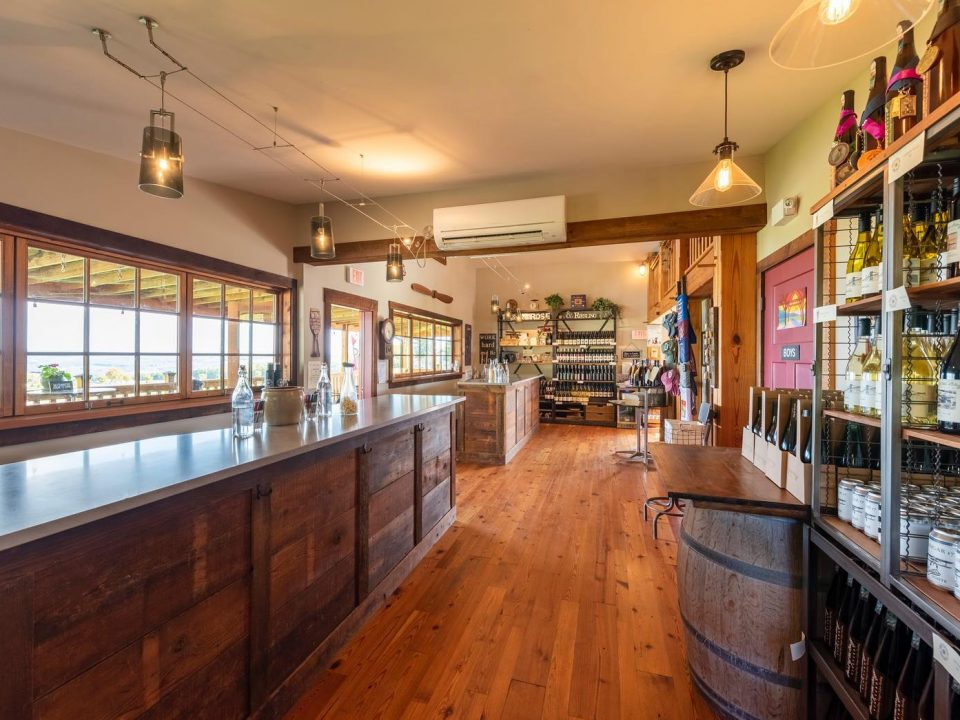 vineyards large tasting room with long bar lots of woodwork and bottles of wine point of the bluff vineyards hammondsport new york united states ulocal local products local purchase local produce locavore tourist