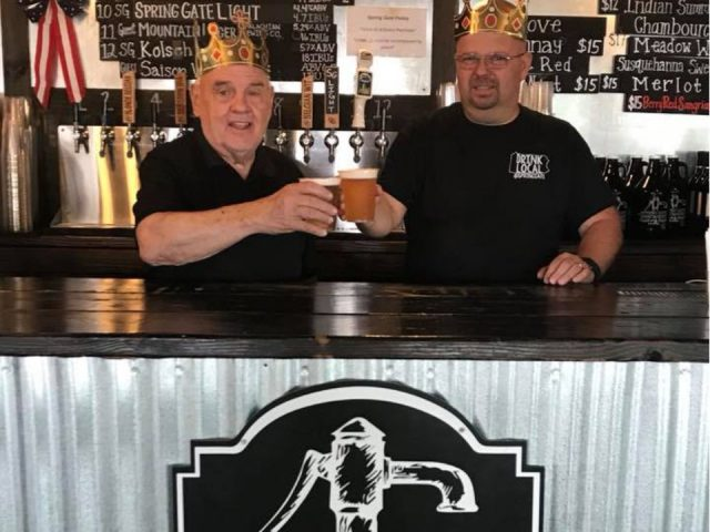 microbreweries 2 men behind the tasting bar with a glass of beer in hand spring gate brewery harrisburg pennsylvania united states ulocal local products local purchase local produce locavore tourist
