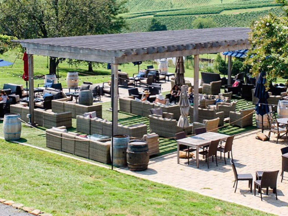 vineyards beautiful terrace lounge with sofas and outdoor chairs on the estate stone tower winery leesburg virginia united states ulocal local products local purchase local produce locavore tourist