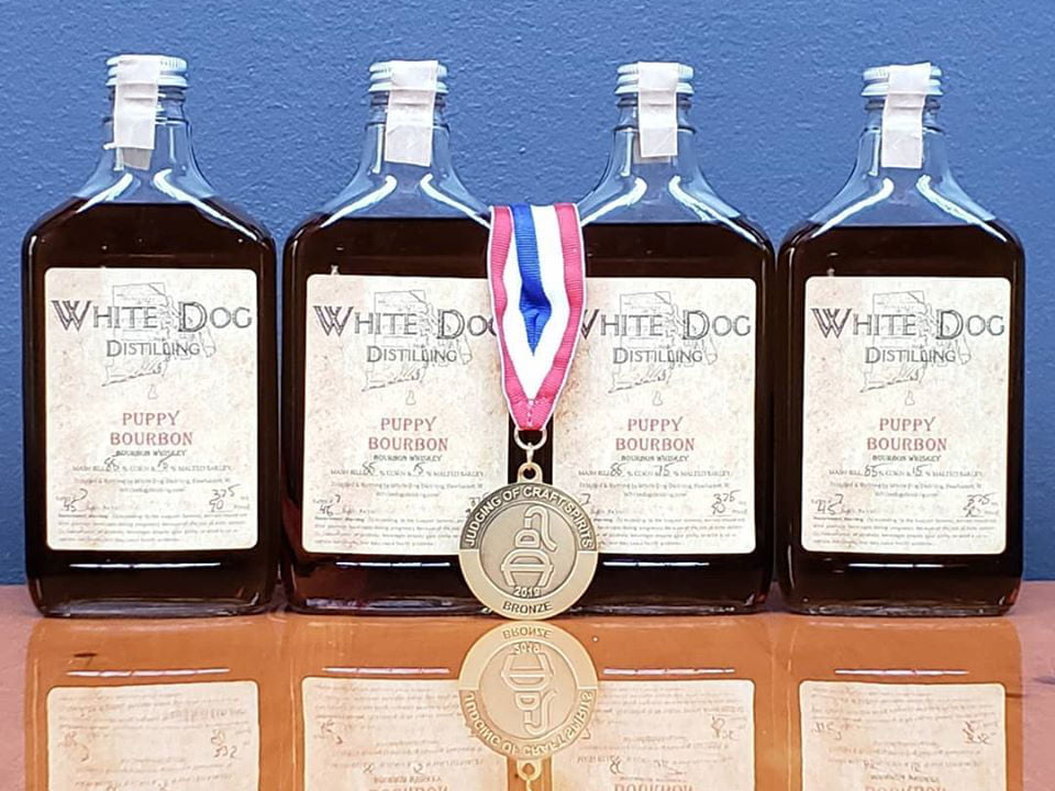 liquor 4 bottles of award-winning puppy bourbon white dog distilling pawtucket rhode island united states ulocal local products local purchase local produce locavore tourist