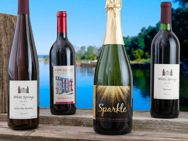 vineyards assortment of 4 bottles of wine from the vineyard with lake view in the background white springs winery geneva new york united states ulocal local products local purchase local produce locavore tourist